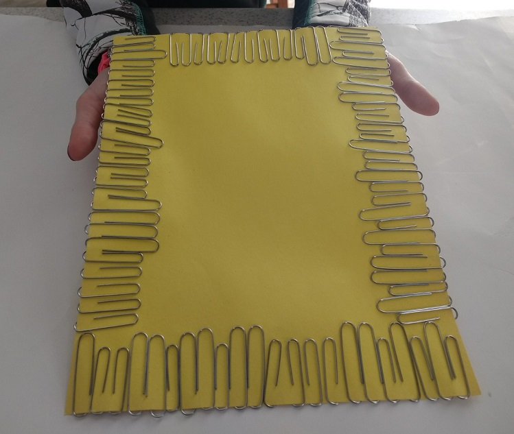 paperclips around paper fine motor activity