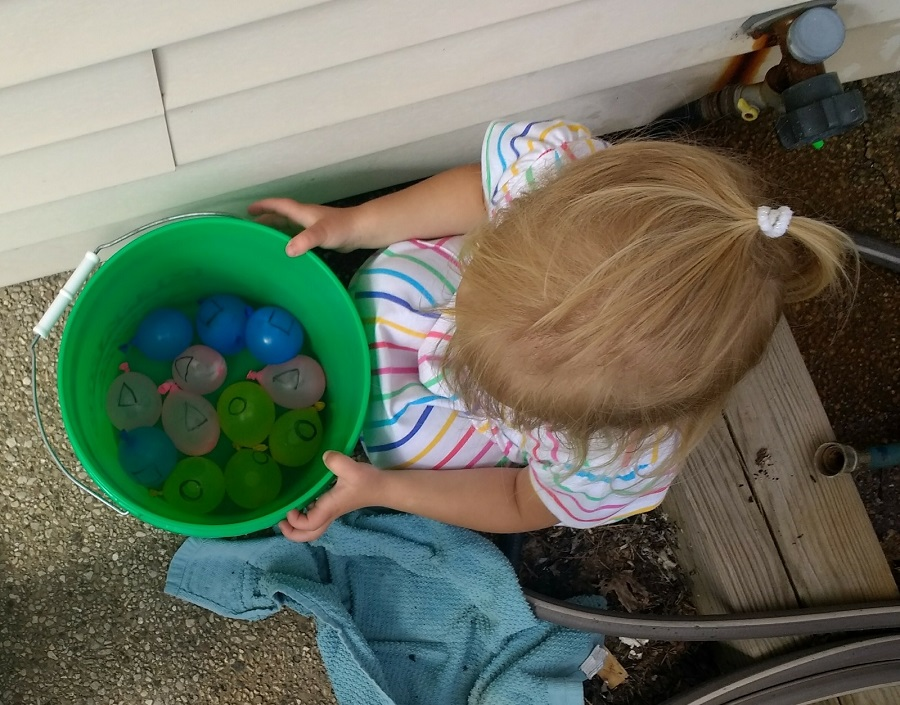 Bucket with water balloons